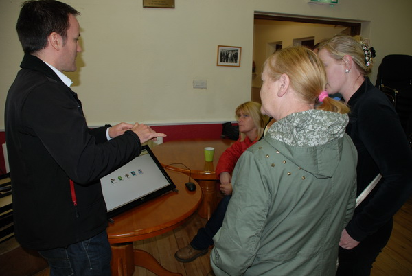 James Sweeney, Limerick City Council demonstrating DIEGO to a group of ladies in King's Island Youth and Community Centre
