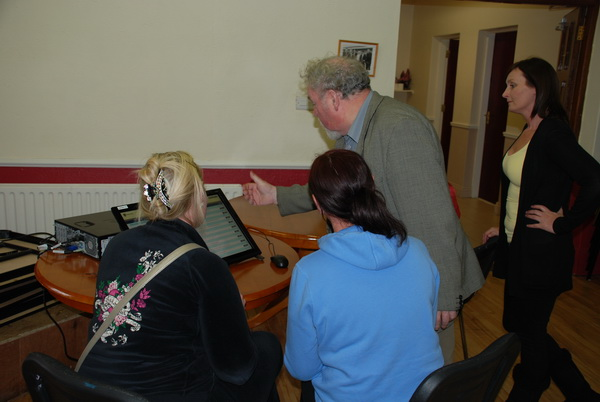 Councillor John Gilligan demonstrating DIEGO to a group of ladies in King Island Youth and Community Centre